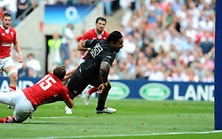 Photo © SPORTZPICS / SECONDS LEFT IMAGES 2011 - Rugby Union - Investic - World Cup warm up game - England V Wales - 06/08/11 - England's Manusamoa Tuilagi beats the tackle of Wales' Rhys Priestland to score between the posts just after the restart - at Twickenham Stadium UK - All rights reserved