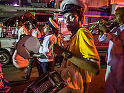 """22 OCTOBER 2015 - YANGON, MYANMAR: Hindu musicians participate in an evening procession to honor the goddess Durga on the last day of Navratri in the Sri Kali temple in Yangon. Navratri, literally """"nine nights"""" is a Hindu festival devoted to the Goddess Durga. Navratri festival combines ritualistic puja (prayer) and fasting. Navratri in India follows the lunar calendar and is celebrated in September/October as Sharad Navratri. It's widely celebrated in countries in Southeast Asia that have large Hindu communities, including Myanmar (Burma). Many of Myanmar's Hindus are descendants of Indian civil servants and laborers who came to Myanmar when it was the British colony of Burma.   PHOTO BY JACK KURTZ"""