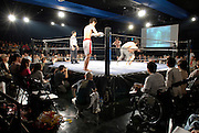 Spectators watch a wrestling bout. 350 people attended the event, the 76th organized by the Doglegs wrestling group.