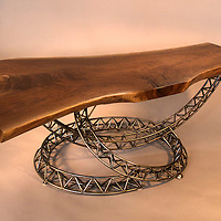 Coffee table<br /> Walnut and steel<br /> this is the second piece in my 'structural steel' series