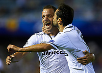 VALENCIA, SPAIN - OCTOBER 02:  Jonas (R) of Valencia celebrates scoring with his teammate Roberto Soldado during the UEFA Champions League group F match between Valencia CF and LOSC Lille Metropole at Estadi de Mestalla on October 2, 2012 in Valencia, Spain.  (Photo by Manuel Queimadelos Alonso/Getty Images)