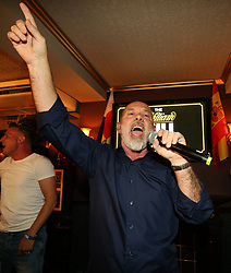 Fat Les aka Keith Allen performs at the Lord Raglan Pub in London as fans watch the World Cup match between Tunisia and England. PRESS ASSOCIATION Photo. Picture date: Monday June 17, 2018. See PA story WORLDCUP England. Photo credit should read: Nigel French/PA Wire