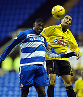 Photograph: Scott Heavey.<br />Reading v Watford. Nationwide Division One. 29/11/2003.<br />Paolo Vernazza (R) out jumps Bas Savage