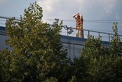 September 2, 2017 - London, London, United Kingdom - Image ©Licensed to i-Images Picture Agency. 02/09/2017. London, United Kingdom. Seven Sisters trespasser. A trespasser on a roof by Seven Sisters station, north London. The trespasser is alleged to have threatened to jump from the roof. Police have cordoned off the street and the incident has caused major disruption to train services. Picture by David Mirzoeff / i-Images (Credit Image: © David Mirzoeff/i-Images via ZUMA Press)