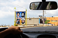 Qana, Lebanon - September 2, 2010: A roadside display of several important Shiite figures near the town of Qana in southern Lebanon. The portraits include the Ayatollah Khomeini of Iran (upper left); Abbas al-Musawi, who was Secretary General of Hezbollah until his assassination in 1992 (upper right), and Imad Mughniyah, a Hezbollah leader assassinated in 2008 (lower left).