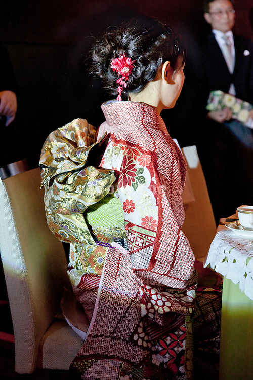 young adult woman in the traditional formal furisode style kimono dress for unmarried women with father