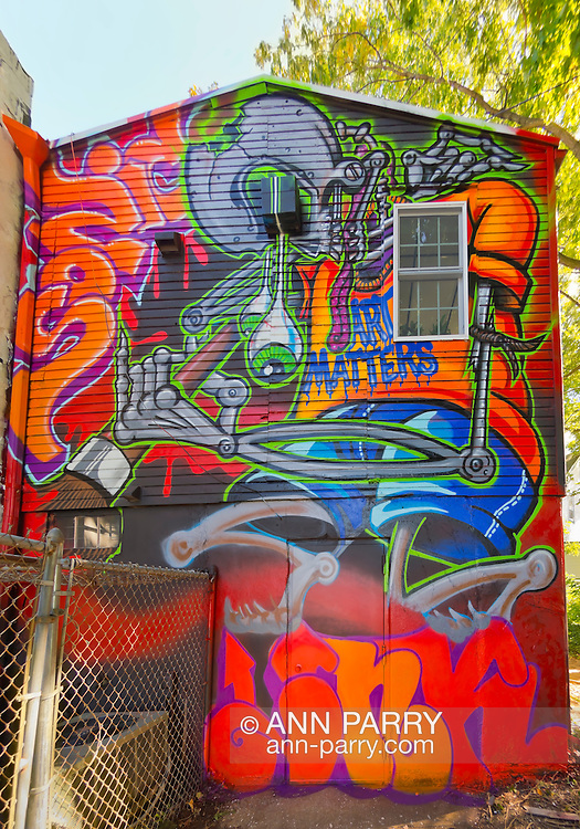 """Huntington, New York, U.S. 24th August 2013. Sonic Bad, legendary street artist Jesse Rodriguez from the Bronx, graffiti painted, with Ink76, the """"Art Matters"""" wall, on the back of the Huntington Arts Council building, during the the art event """"Off the Walls"""" Block Party, by SPARKBOOM, a project the council created to help emerging artists, showcase talents, and help its artistic family network."""