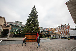 © Licensed to London News Pictures. 23/11/2020. London, UK. A quiet Covent Garden in London as office workers stay away from the City. Prime Minister Boris Johnson will address the Nation tonight to set out his plans for Christmas and the end of lockdown 2.0 with the opening up of shops and restaurants. However he will also introduce a new tougher three-tiered system with further localised restriction to the hospitality industry, Christmas office parties and pub opening hours. Photo credit: Alex Lentati/LNP