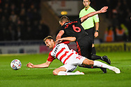 Herbie Kane of Doncaster Rovers (15) is fouled by Lee Cattermole of Sunderland (6) during the EFL Sky Bet League 1 match between Doncaster Rovers and Sunderland at the Keepmoat Stadium, Doncaster, England on 23 October 2018.
