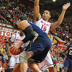 Rutgers Scarlet Knights guard/forward Derrick Randall (15) posts up on defense against Notre Dame Fighting Irish forward Mike Broghammer (33) during Big East NCAA action during Rutgers' 65-58 victory over Notre Dame at the Louis Brown Athletic Center in Piscataway, N.J.