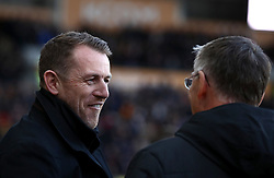 Derby County manager Gary Rowett (left) chats with Hull City's manager Nigel Adkins before the start of the match