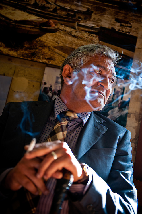 Assif Hamid Rajeb, a writer and poet, smokes a cigarette in the Shabander Café on Al Mutanebbi Street.