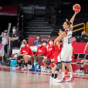 TOKYO, JAPAN August 8:  A smiling Diana Taurasi #12 of the United States holds the ball aloft as Nako Motohashi #15 of Japan defends during the Japan V USA basket final for women at the Saitama Super Arena during the Tokyo 2020 Summer Olympic Games on August 8, 2021 in Tokyo, Japan. (Photo by Tim Clayton/Corbis via Getty Images)