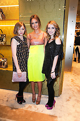 Left to right, CHLOE MORETZ, JESSICA ALBA at a Cocktail party to celebrate the opening of the new Miu Miu boutique, 150 New Bond Street, London hosted by Miuccia Prada and Patrizio Bertelli on 3rd December 2010.