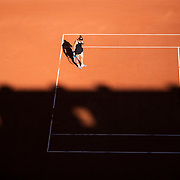 PARIS, FRANCE June 10. Maria Sakkari of Greece during her match against Barbora Krejcikova of the Czech Republic as the early evening shadows creep across Court Philippe-Chatrier during the semi finals of the Women's singles competition at the 2021 French Open Tennis Tournament at Roland Garros on June 10th 2021 in Paris, France. (Photo by Tim Clayton/Corbis via Getty Images)