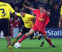 Liverpool's Michael Owen and Dortmund's Stefan Reuter during the UEFA Champions League match at the Westfalenstadion.