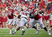 Sep 15, 2012; Fayetteville, AR, USA;  Alabama Crimson Tide defensive lineman Damion Square (92) is held by Arkansas Razorback offensive Guard Alvin Bailey (67) as quarterback Brandon Allen (10) looks for a pass during the second half at Donald W. Reynolds Razorback Stadium. Alabama defeated Arkansas 52-0. Mandatory Credit: Beth Hall-US PRESSWIRE
