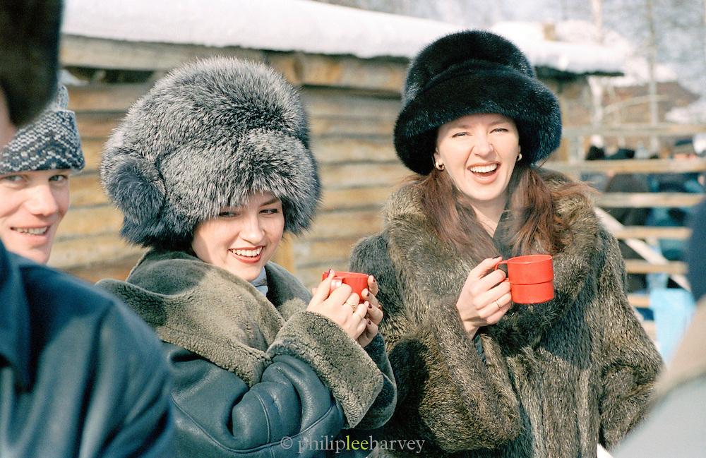Visitors to the Farewell To Winter Festival, Listvyanka, Siberia, Russia