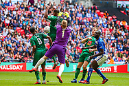 Cray Valley's Kevin Lisbie (10) tussles with Chertsey Town's goalkeeper Nick Jupp (1) and receives a yellow card during the FA Vase final match between Chertsey Town and Cray Valley at Wembley Stadium, London, England on 19 May 2019.