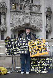 © Licensed to London News Pictures. 06/12/2016. London, UK. An anti-Brexit protestor stands outside the Supreme Court on the second day of a hearing to appeal against a November 3 High Court ruling that Article 50 cannot be triggered without a vote in Parliament. Photo credit: Peter Macdiarmid/LNP