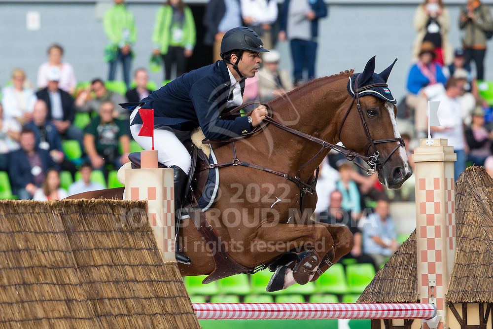 Jamal Rahimov, (AZE), Warrior - Team & Individual Competition Jumping Speed - Alltech FEI World Equestrian Games™ 2014 - Normandy, France.<br /> © Hippo Foto Team - Leanjo De Koster<br /> 02-09-14