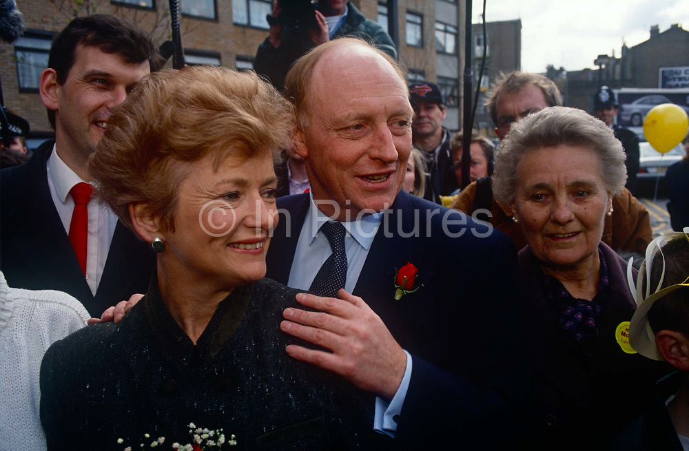 Leader of the Labour party, Neil Kinnock and wife Glenys campaign during the 1992 election on 5th May 1992, in London, UK. Labour made considerable progress in the election that year reducing the Conservative majority to just 21 seats. It came as a shock to many when the Conservatives won a majority, but the triumphalism perceived by some observers of a Labour party rally in Sheffield may have helped put floating voters off. Neil Gordon Kinnock, Baron Kinnock PC b1942 is a British Labour Party politician. He served as a Member of Parliament from 1970 until 1995, first for Bedwellty and then for Islwyn. He was the Leader of the Labour Party and Leader of the Opposition from 1983 until 1992, making him the longest-serving Leader of the Opposition in British political history.