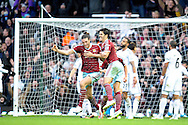 Andy Carroll of West Ham United (l) celebrates with teammate James Tomkins of West Ham United after scoring his sides second goal of the game to make it 2-1. Barclays Premier league match, West Ham Utd v Swansea city at the Boleyn ground, Upton Park in London on Sunday 7th December 2014.<br /> pic by John Patrick Fletcher, Andrew Orchard sports photography.
