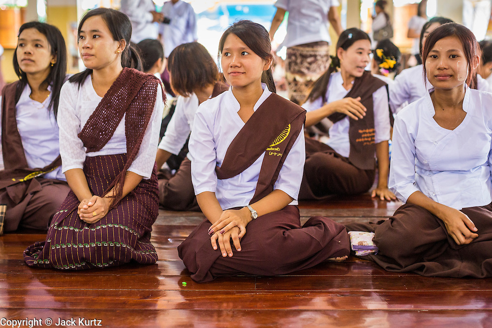 24 MAY 2013 - MAE SOT, THAILAND: Burmese women gather in Wat Pha Mai for Visakha Puja Day services. Visakha Puja (Vesak) marks three important events in the Buddha's life: his birth, his attainment of enlightenment and his death. It is celebrated on the full moon of the sixth lunar month, usually in May on the Gregorian calendar. This year it is on May 24 in Thailand and Myanmar. It is celebrated throughout the Buddhist world and is considered one of the holiest Buddhist holidays. Burmese Buddhist in Mae Sot celebrated with a procession through Mae Sot that ended with a service followed by a communal meal at Wat Pha Mai, the most important Burmese Buddhist temple in Mae Sot.   PHOTO BY JACK KURTZ