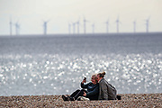 A couple is seen taking a selfie as they enjoy the sunny weather along the Brighton Beach on Sunday, April 11, 2021.  On Monday, April 12, England enters the next stage of government's roadmap out of lockdown, when the non-essential shops, outdoor hospitality, and personal services including hairdressing can open again. (Photo/ Vudi Xhymshiti)
