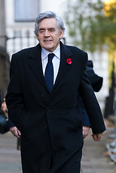 © Licensed to London News Pictures. 10/11/2019. London, UK. Former Prime Minister, Gordon Brown walks through Downing Street to attend the Remembrance Sunday Ceremony at the Cenotaph in Whitehall. Remembrance Sunday events are held across the country today as the UK remembers and honours those who have sacrificed themselves in two world wars and other conflicts. Photo credit: Vickie Flores/LNP