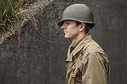 USA, Oregon, Astoria, Ft. Stevens State Park, living historian infantry soldier resting. MR