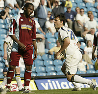 Photo: Aidan Ellis.<br /> Leeds United v Burnley. Coca Cola Championship. 14/04/2007.<br /> Leeds Robbie Blake reacts to a challenge from Burnley's Eric Djemba-Djemba