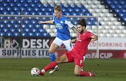 Frankie Kent of Peterborough United in action with Harry Cardwell of Chorley - Mandatory by-line: Joe Dent/JMP - 28/11/2020 - FOOTBALL - Weston Homes Stadium - Peterborough, England - Peterborough United v Chorley - Emirates FA Cup second round