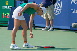 August 19, 2018 - Mason, Ohio, USA - Simona Halep (ROU) reaches to pick up her racket after throwing it to the court during Sunday's final round of the Western and Southern Open at the Lindner Family Tennis Center, Mason, Oh. (Credit Image: © Scott Stuart via ZUMA Wire)