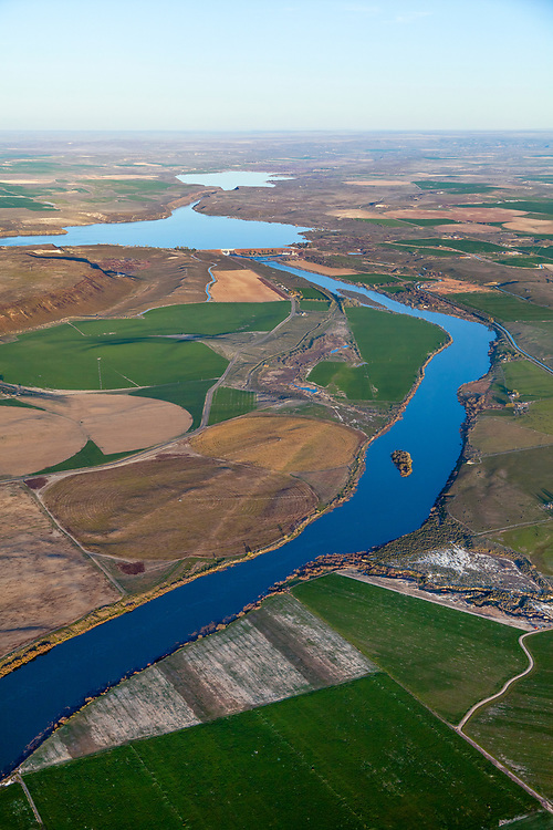 Snake River Aerial view in Springtime with CJ Strike Reservoir in background in the last evening light near Bruneau Idaho. Licensing and Open Edition Prints.