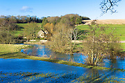 Flooded fields as the River Windrush burst its banks after heavy rain near Burford in The Cotswolds, Oxfordshire, United Kingdom