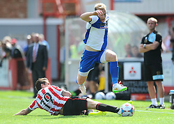 Danny Greenslade of Bristol Rovers skips past a challenge from James Rowe of Cheltenham Town - Mandatory by-line: Dougie Allward/JMP - 25/07/2015 - SPORT - FOOTBALL - Cheltenham Town,England - Whaddon Road - Cheltenham Town v Bristol Rovers - Pre-Season Friendly