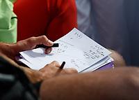 Tennis - 2019 Queen's Club Fever-Tree Championships - Day Six, Saturday<br /> <br /> Men's Singles, Semi Final: Daniil Medvedev (RUS) Vs. Gilles Simon (FRA) <br /> <br /> Daniil Medvedev (RUS) coach makes notes on Centre Court.<br />  <br /> COLORSPORT/DANIEL BEARHAM