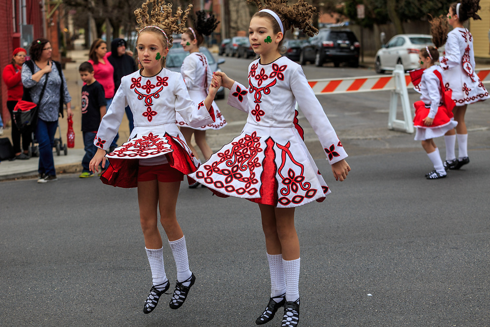 York, PA / USA - March 12, 2016: Costumed girls dance in the street to entertain the crowd watching the annual Saint Patrick's Day Parade.