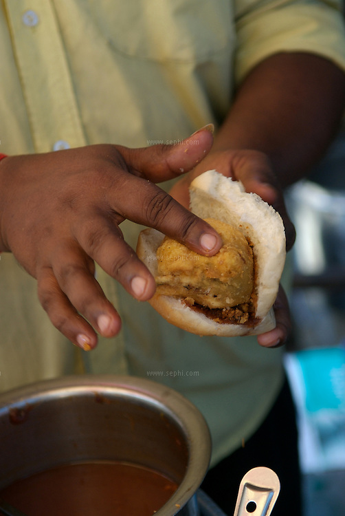 Vada Pao ( aka poor man's burger), is probably the most popular dish of Mumbai. for anywhere between 2-5 rupees anyone can have a full meal. Vada is a potato dumpling deep fried in oil, and Pao, which actually came to Maharashtra from Goa, is very similar to Portuguese bread (Goa used to be a Portuguese colony).