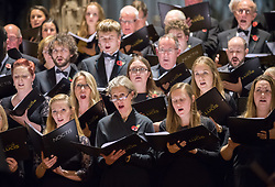 © Licensed to London News Pictures. 10/11/2018. Bristol, UK. The Royal British Legion Festival of Remembrance 1918-2018 at Bristol Cathedral. The Noctis Choir perform. On the eve of the Centenary of the end of the First World War the Royal British Legion holds a special Festival of Remembrance in Bristol Cathedral, bringing together musical talent from across the region presenting a poignant tribute from a variety of local performers. The second part of the evening will crescendo with a performance of Karl Jenkins' The Peacemakers by the 120 Members of Lucis and Noctis Choirs and the Southern Sinfonia Orchestra directed by Francis Faux. The piece is dedicated to all those who have lost their lives during armed conflict. During WW1 Soldiers from all over the World from numerous Continents, Commonwealth Countries and Nations Worldwide of all faiths castes creeds and religions served fought and died for Britain. The British Empire's colonies sent over two and a half million men to fight for Britain during the war, and 400,000 Muslims fought for Great Britain. The Lord Mayor Cleo Lake with Kizzy Morell represents the 60,000 Black South Africans, 15,600 Caribbean and 120,000 Africans who fought in WW1.<br /> Babbi Channa represents the 100,000 Sikhs, One million Indians who fought in WW1<br /> Chinese lady; Represents 140,000 Chinese Labour Corps Members<br /> Muslim lady; Representing the 400,000 Muslims who fought in WW1<br /> Nepalese lady; Representing the 90,000 Ghurkhas who fought in WW1<br /> (Last three representatives pupils from Badminton School )<br /> Photo credit: Simon Chapman/LNP