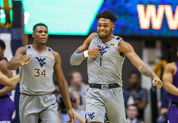 Jan 14, 2020; Morgantown, West Virginia, USA; West Virginia Mountaineers forward Derek Culver (1) celebrates after basket during the first half against the TCU Horned Frogs at WVU Coliseum. Mandatory Credit: Ben Queen-USA TODAY Sports