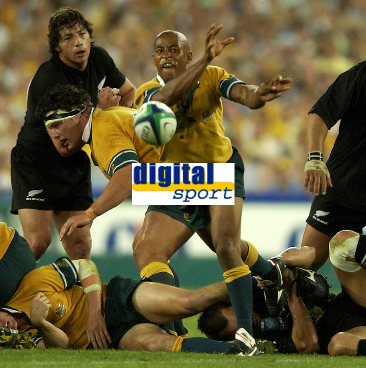 Photo: Richard Lane.<br />New Zealand v Australia. Semi-Final, at the Telstra Stadium, Sydney. RWC 2003. 15/11/2003. <br />George Gregan gets the ball away.