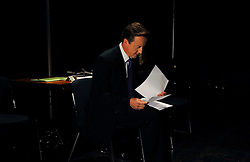 Leader of the Conservative Party David Cameron looks through his speech  in the green room minutes before going on stage to deliver his  speech to the  Conservative Party Conference   , Thursday   October 8 , 2009.  .