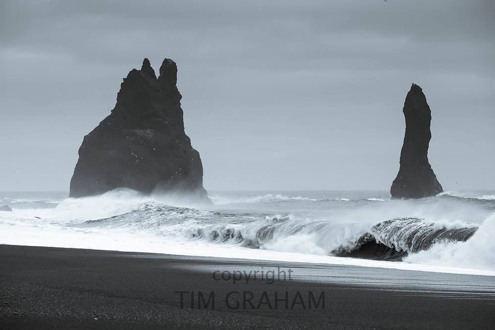 Reynisdrangar basalt sea stacks (troll rocks) and black volcanic sand beach Reynisfjara near the village Vík i Myrdal, South Iceland