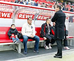 30.10.2010,  Rhein Energie Stadion, Koeln, GER, 1.FBL, FC Koeln vs Hamburger SV, 10. Spieltag, im Bild: Faryd Mondragon (Koeln #1 / sitzt neben seinem Sohn ) und Petit (Koeln #8 / stehend vor der Spielerbank ) stehen heute nicht im Aufgebot der Koelner Mannschaft  EXPA Pictures © 2010, PhotoCredit: EXPA/ nph/  Mueller+++++ ATTENTION - OUT OF GER +++++
