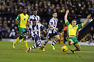 right in front of goal, WBA's Stephane Sessegnon © puts his shot just wide of goal. Barclays Premier league, West Bromwich Albion v Norwich city at the Hawthorns in West Bromwich, England on Sat 7th Dec 2013. pic by Andrew Orchard, Andrew Orchard sports photography.