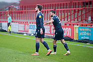 GOAL 2-1 Morecambe forward Cole Stockton (9) celebrates putting his side ahead with Morecambe defender Stephen Hendrie (3)  during the EFL Sky Bet League 2 match between Stevenage and Morecambe at the Lamex Stadium, Stevenage, England on 6 February 2021.