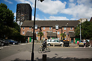 The view of the burned out tower behind local housing and trees  June 16th 2017, London, United Kingdom. Grenfell Tower burned out after a catastophic fire killing more than 58 people. The tower caught fire early Wednesday morning and final casualty figueres may end up to be many more with police not expecting to be able to find and recover all bodies and to find all missing people. No fire sprinkler in place and cheap cladding made with plastic is so far blamed for the ferocious fire.