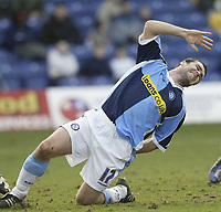 Photo: Aidan Ellis.<br /> Mansfield Town v Wycombe Wanderers. Coca Cola League 2. 24/02/2007.<br /> Wycombe's Scott McGleish shows the pain after stretching for  a pass